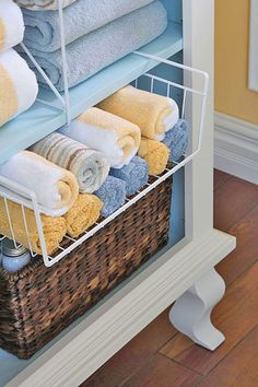 Use dividers and roll-out bins for towels. Great way to keep the closets organized. small bathroom storage, bathroom ideas, linen closets, wire baskets, cabinet storage, terracotta pots, storage ideas, towel storage, guest bathrooms