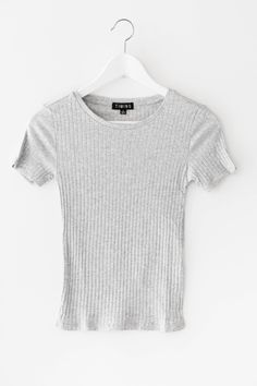 Basic round neck crop top with short sleeves and a slightly cropped fit. Made…