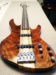 22 steps to an incredible bass guitar. From old pieces of wood to this beauty.