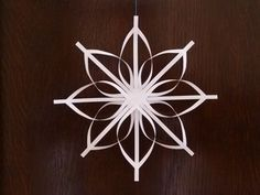 How to Make a Star Christmas Tree Ornament - Step by Step Homemade Paper Crafts The secret of how to make a star ornament that looks beautiful and intricate, but is surprisingly simple to make. A homemade Christmas decoration your friends will marvel at! Homemade Christmas Decorations, Christmas Paper Crafts, Noel Christmas, Christmas Projects, Handmade Christmas, Christmas Tree Ornaments, Holiday Crafts, Simple Christmas, Snowflake Ornaments