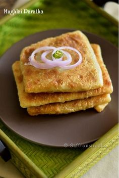 Mughlai paratha / minced meat stuffed paratha fortified with eggs and shallow fried, from India