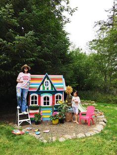 rainbow painted playhouse from Alisa Burke Painted Playhouse, Build A Playhouse, Simple Playhouse, Plastic Playhouse, Playhouse Kits, Backyard Playhouse, Outdoor Play, Outdoor Decor, Alisa Burke