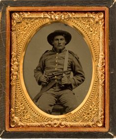tintype portrait of Confederate Infantryman armed with a revolver and Bowie knife via Heritage Auctions