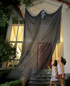 I think anyone could DIY this spooky halloween decor with a mask, fabric, and command hooks