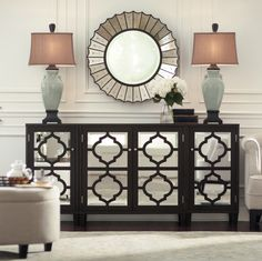 Mirrored furniture reflects light and makes any room look a little bigger. HomeDecorators.com