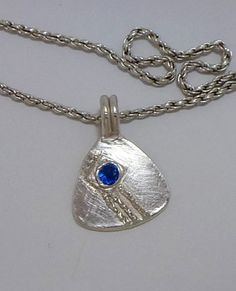 Fine silver necklace with NA symble and blue CZ. Order with name and clean date.