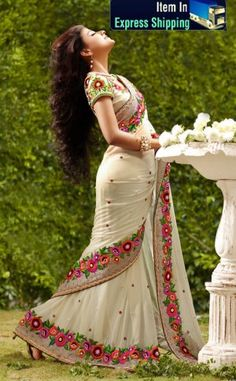 Cream Color Georgatte Designer Saree.  Saree is crafted with Resham,Sequins And patch work .  Fabric -Georgatte.  Color - Cream.  Length of sarees with attached blouse pc. is 6.25 mtrs.  Costume/Outfit - Saree with Blouse piece.      #Designer_sarees #Indian_sarees #Sarees_online