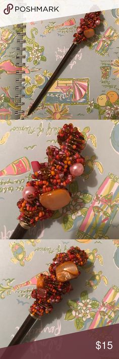 Hair Accessory from Venice Italy Beautiful wooden and beaded hair accessory from Venice, Italy! Beading includes colors orange, amber, pink and red with a few larger beads! If you have any questions don't hesitate to ask! Accessories Hair Accessories