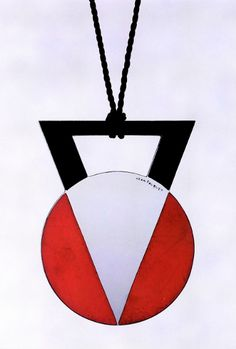 JEAN FOUQUET - White metal applied with a geometric design in red and black lacquer, circa 1928, signed.