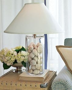 Lately I've been noticing more and more decor sources offering clear glass lamps designed for displaying small objects (A. Decor, Lamp, Pretty Furniture, Beautiful Furniture Pieces, Trending Decor, Coastal Decorating Living Room, Bottle Lamp, Glass Lamp, Cool Lamps