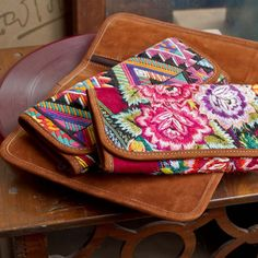 Buttery nubuck & colorful recycled huipile wallets in lush florals & bold geometrics **Altiplano