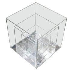 Lucite Sculpture Cube Table, 1960s. Small square sculptural lucite side table consisting of four squares of descending size with mirrored bottom.
