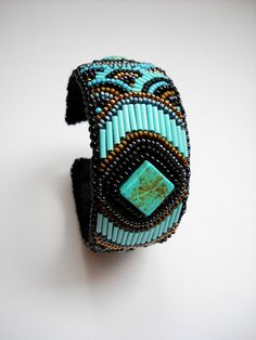 Mayan Kaleidoscope - Bead embroidery-Anna Hatveni-the bugle beads always get to me Embroidery Floss Bracelets, Bead Embroidered Bracelet, Beaded Cuff Bracelet, Bead Embroidery Jewelry, Beaded Embroidery, Beaded Jewelry, Cuff Bracelets, Jewellery, Bracelets Design