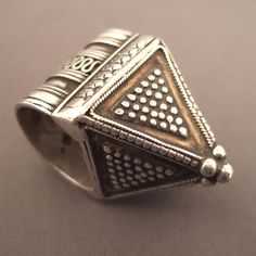 "Silver, Kazakstan   Description  A Kazak ring with a design that blends the pyramidal shape and beautiful granulations ... a true treasure that contains a ball supposed to represent the soul of his owner ...  Size:9 adaptable    Weight:22,5gr    www.halter-ethnic.com...see ""My Lucky Finds"""