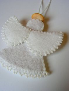 I like the beaded wings and the trim on the dress.  Also, perhaps use one of Mom's vintage buttons for the halo. - - - Christmas felt angel decoration MADE TO ORDER. $12.00, via Etsy.