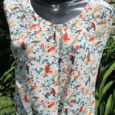"Tie Front Bird Print Top Light & breezy semi crop. Lace insets on shoulders. Beautiful teal, peach, burnt orange print.  Measured flat. 17"" across bust. 19"" long. Tagged xs, will fit s. Eyeshadow Tops Crop Tops"