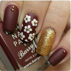 Floral nail art- deep brownish red nails, daisies, gold glitter