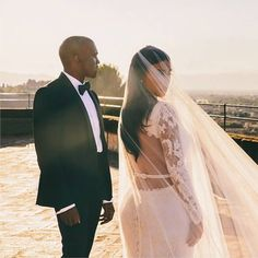 Who says bridal hair has to be fussy! We LOVE newly wed Kim Kardashian-West's bridal hair! Simple middle part, sleek and straight back - perfecto!