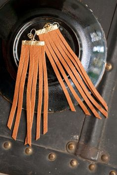 truth be told  long leather earrings  saddle tan by heidiroland, $32.00