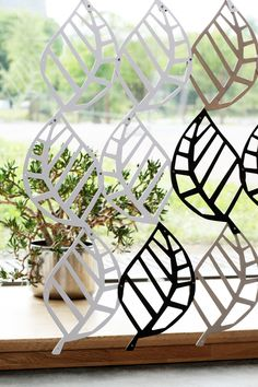 Wooden lace is room devider or window cover. The wooden equivalent is contrasting – its fragility is only visual, amplified through the various ways the light plays on large surfaces.