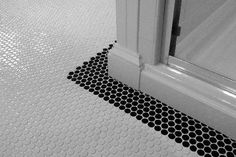 White penny round tile with a black penny tile border. Penny Tile Floors, Bathroom Floor Tiles, Basement Bathroom, Bathroom Ideas, Master Bathroom, Bathroom Remodeling, Small Bathroom, Floor Grout, 1950s Bathroom