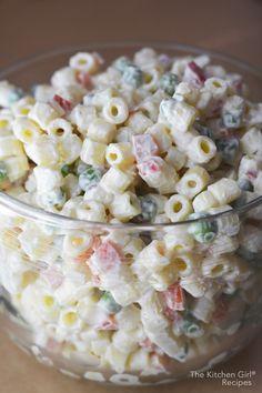 Secretly healthy, summer picnic food! Classic Macaroni Salad Made With Greek Yogurt is creamy, zesty, and made with no sugar. thekitchengirl.com