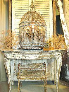 chandelier hanging inside birdcage