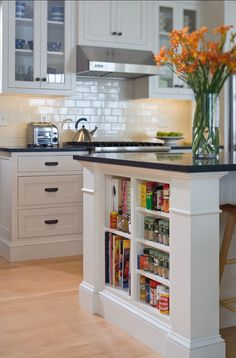 This is a great kitchen with classic black & white elements.-- LOVE The booksheles