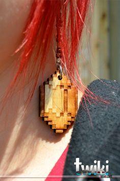 Laser cut and engraved Zelda Rupee wood earrings.