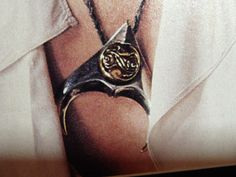 I'd forgotten I owned the Labyrinth photo album (C) Henson Associates, Inc. I know plenty of people wanted a clear picture of Jareth's necklace, so this. David Bowie Labyrinth, Labyrinth 1986, Labyrinth Movie, Labyrinth Tattoo, Jim Henson Labyrinth, Terry Jones, Necklace Tattoo, Christina Rossetti, Goblin King