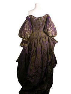 """""""The Three Musketeers."""" (2011) Milady (Milla Jovovich)  Purple and green brocade Milady gown.  Back."""