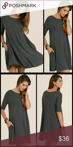 Ash Fall Dress Comfortable, beautiful and perfect for fall. A relaxed, a line, half sleeve, solid dress with pocket details.   Cotton blend. Dresses
