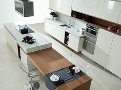 Modern Kitchen Interior Contemporary kitchen with combination island bench with stools in table setting - Modern-contemporary kitchen ideas Kitchen Island Bench, Modern Kitchen Island, Kitchen Dinning, Modern Kitchen Design, Kitchen Cabinets, Kitchen Worktops, Dinning Table, Kitchen Islands, White Cabinets