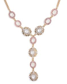 Create hypnotizing allure with this Y-necklace adorned in clear and pink crystals and pearly stones. About the Necklace: Total length is 17.5, with a 3 extender, 8 neck drop and lobster clasp closure.
