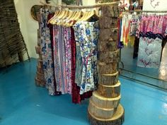 Clothes rack.. Visual merchandising... We could probably make these, I would want a steel/ industrial pipe