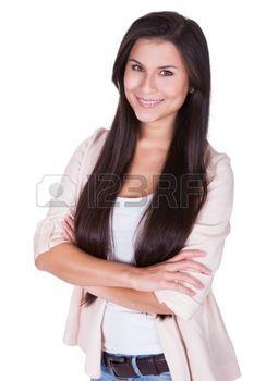 Retrato de longitud completa aislado estudio de una mujer joven de moda en jeans casuales y tacones de aguja que presenta en una postura relajada en blanco photo