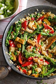 - Veggie rice bowl You can be tucking into this virtuous bowlful of veggies, rice and gorgeous Asian flavours, in just 15 minutes. This super easy recipe gives a delicious vegetarian dinner which is ideal for when time is short. Veggie Rice Bowl, Veggie Dishes, Veggie Recipes With Rice, Vegetarian Rice Bowl Recipe, Rice Bowls, Quick Vegetarian Meals, Vegetarian Sandwiches, Going Vegetarian, Vegetarian Breakfast