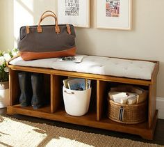 I want to aim for an entry bench like this when I repurpose the old sturdy coffeetable. Pottery Barn: Samantha Entryway Bench