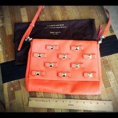 """KATE SPADE Bow Terrace Konnie Leather Shoulder Bag Like New Condition!!! Authentic!!! 100% Leather! Adjustable chain link and leather shoulder strap! Bow and pyramid stud detail at front. Polka dot interior lining with a zip pocket. Flap opening with magnetic snap closure. Measurements: 11""""L x 8""""H x 1.75""""D. Strap drop 22"""". Super cute for casual or date night!!! ;) kate spade Bags Shoulder Bags"""