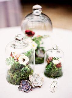 Floral cloches with a moss base wedding centerpiece / http://www.himisspuff.com/glass-cloche-bell-jar-wedding-ideas/5/