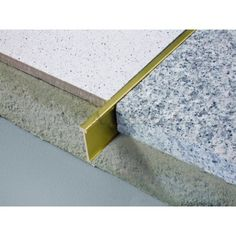 Image result for brass strip between concrete slabs