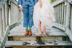 Colorful green, peach, and gold beach wedding at Jupiter Beach Resort & Spa | Striped socks and sparkly wedding shoes | Photo by thebigdayblog.com