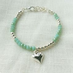 Beautiful limited edition beaded bracelet in silver and green. Skinny bracelets for everyday wear
