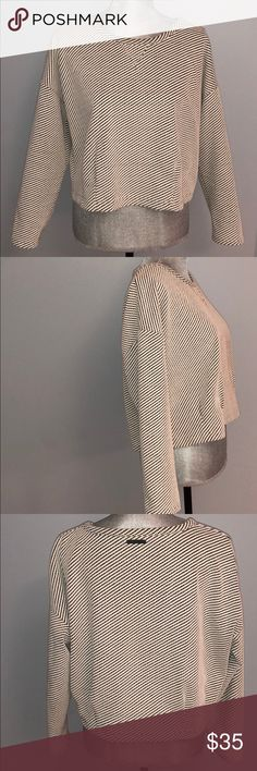 A/X knit cream and black darted at waist top Armani Exchange knit cream and black top. Hits at waist . Has gathered darts at waist . Has stretch. Never worn in excellent condition. Looks great with pencil skirt . Is designer so runs small. Fits more like a medium . A/X Armani Exchange Sweaters Crew & Scoop Necks
