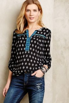 Love the black and white pattern and the teal details on the shirt. I like the boho style of this one piece for something different. I liked the stacked silver bracelets too.