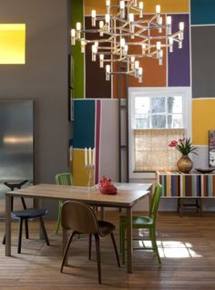 Love the geometric block of color! They marry well with the neutrality of the rest of the room.