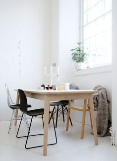 White scandi dining room with designer chairs, Eames, Muuto.