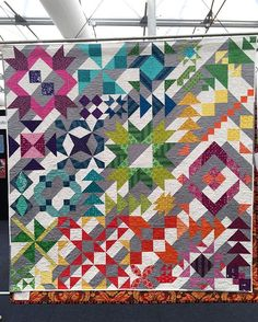 Our group quilt (Grey skies and Rainbow Fields) hanging at the #sydneyquiltandcraftfair This makes me so proud. Everyone did an amazing job on this one.  courtesy of @pennypoppleton #craftandquiltfair