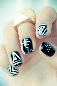 black and white nails with shapes of triangles