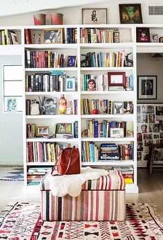 """""""I became obsessed with books—Gone with the Wind,Jane Eyre,Shakespeare—when I was young,"""" Shiva says. """"I think that's why I became an actress, because I wanted to tell stories and be in them."""" She organizes her tomes by theme and breaks up their straight lines and right angles with objets like vintage vases and baskets, old patinaed mirrors, and family photos."""
